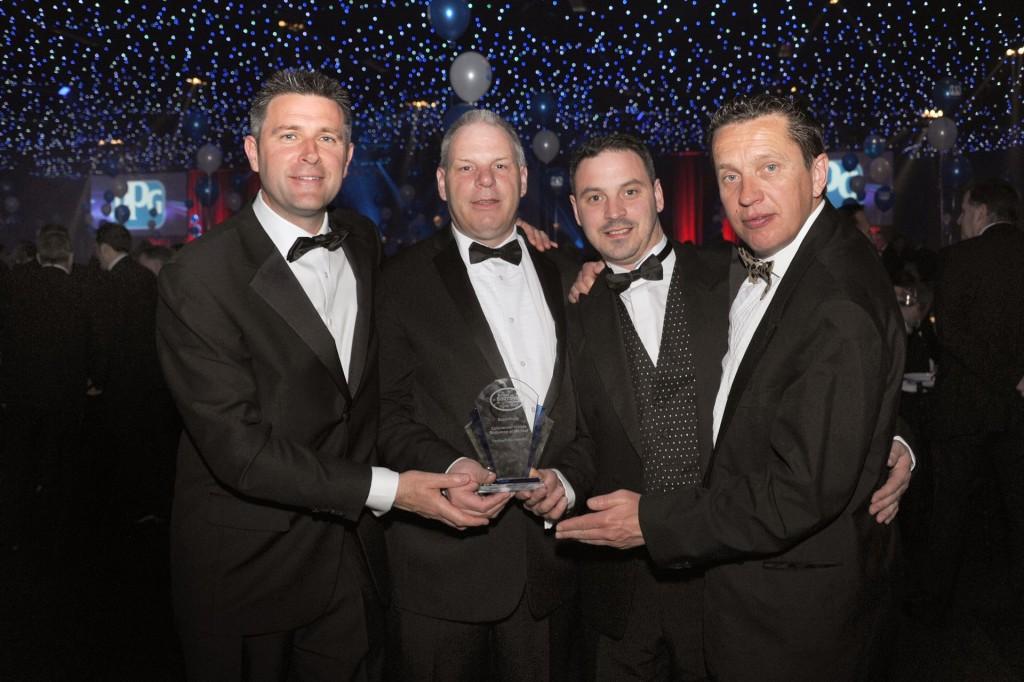 010714 Yaxley - Yaxley Key Team members with the award